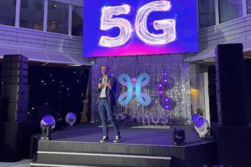Photo de Guillaume Boutin, CEO de Proximus en 2021 devant un écran avec le logo 5G